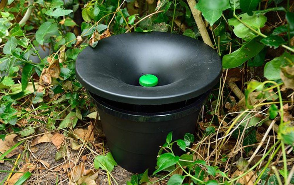 The In2Care mosquito trap installed in a garden.
